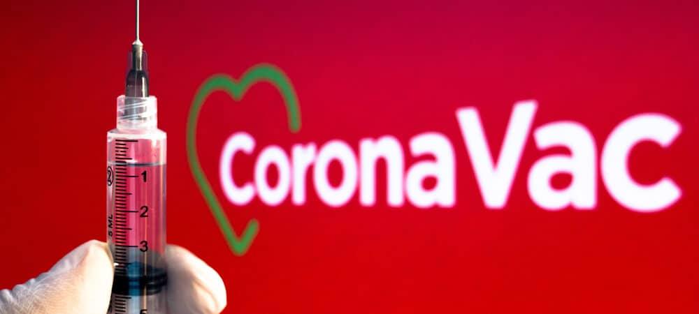 Símbolo CoronaVac e mão de luva segurança dose da vacina