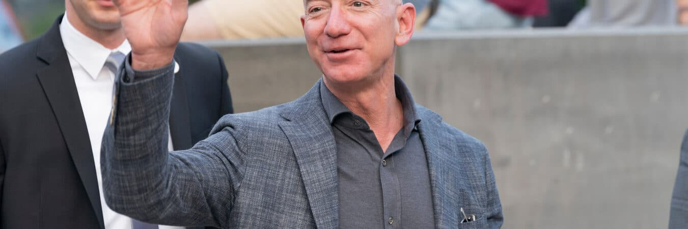 Amazon CEO Jeff Bezos waves at the opening of the Statue of Liberty Museum