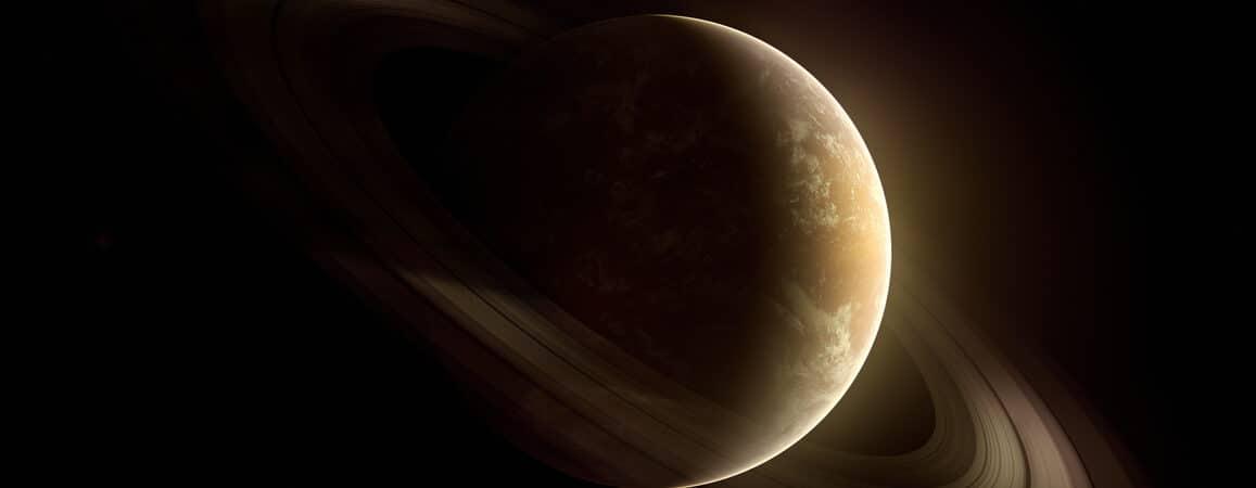 Ilustração representa o planeta Saturno, no fundo escuro do universo com seus anéis em destaque