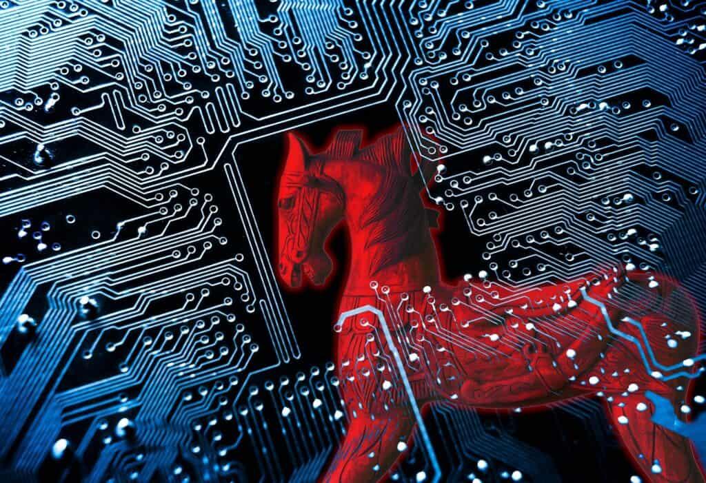 Cavalo de Tróia/símbolo de um cavalo de Tróia vermelho no fundo da placa de circuito do computador azul