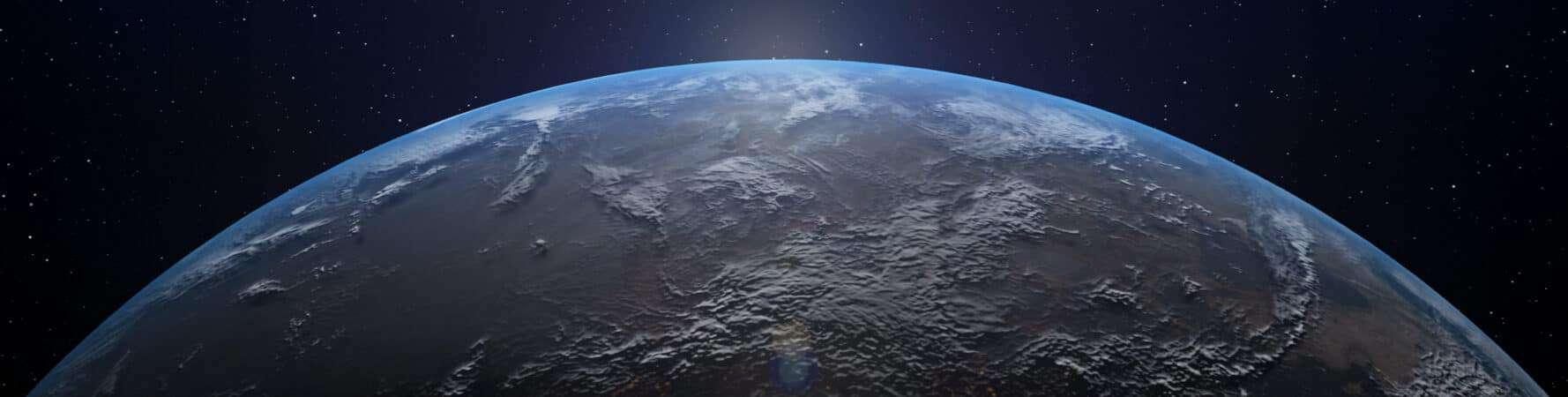 Imagem mostra um pedaço da Terra com o brilho do Sol no horizonte