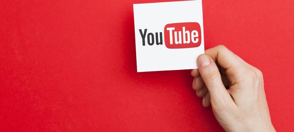 Mão segurando símbolo YouTube