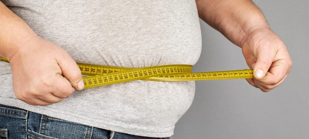 A, Man, Measures, His, Fat, Belly, With, A, Measuring, Tape.