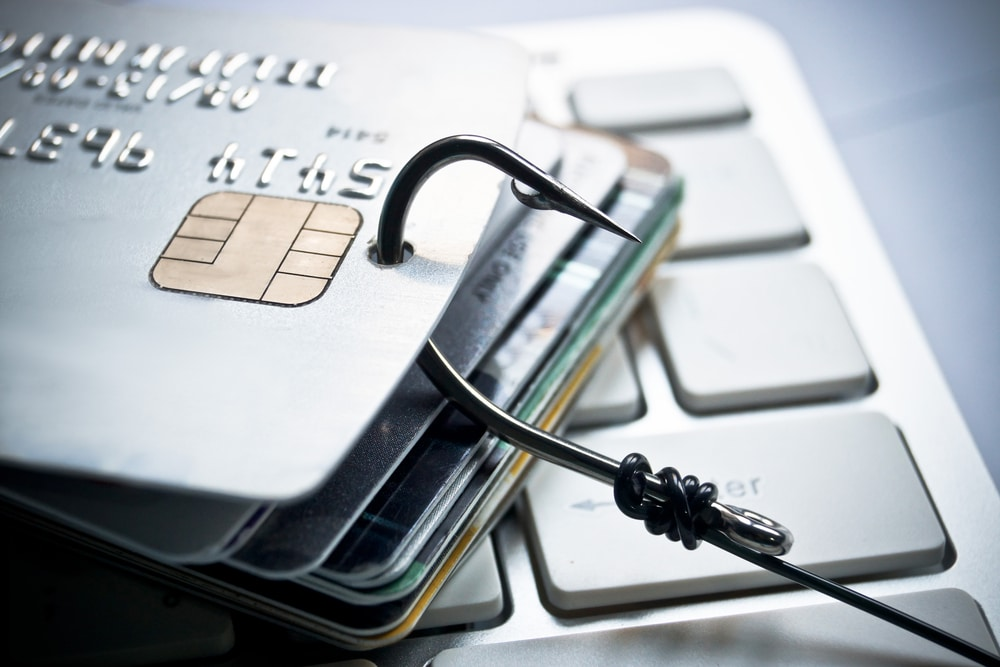 image of credit cards being pierced with a hook