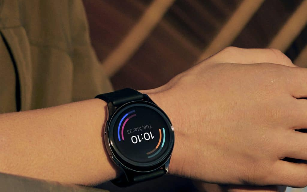 OnePlus Watch smartwatch on a person's wrist.