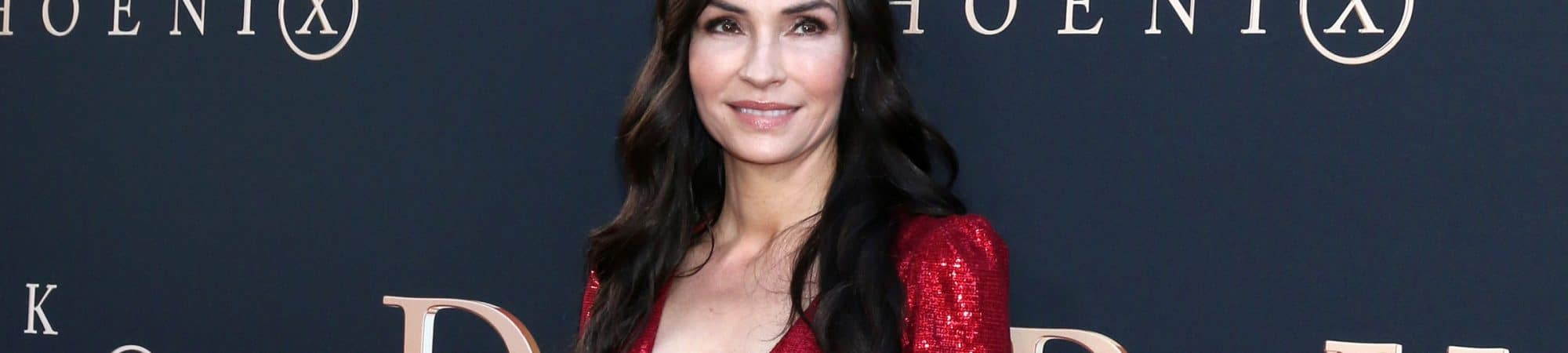 "Famke Janssen na estreia mundial de ""Dark Phoenix"", em junho de 2019 em Los Angeles. Imagem: Kathy Hutchins/Shutterstock"