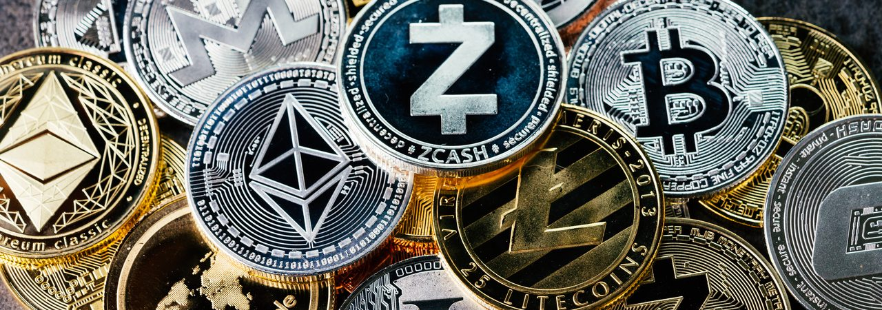 Various cryptocurrencies on a table