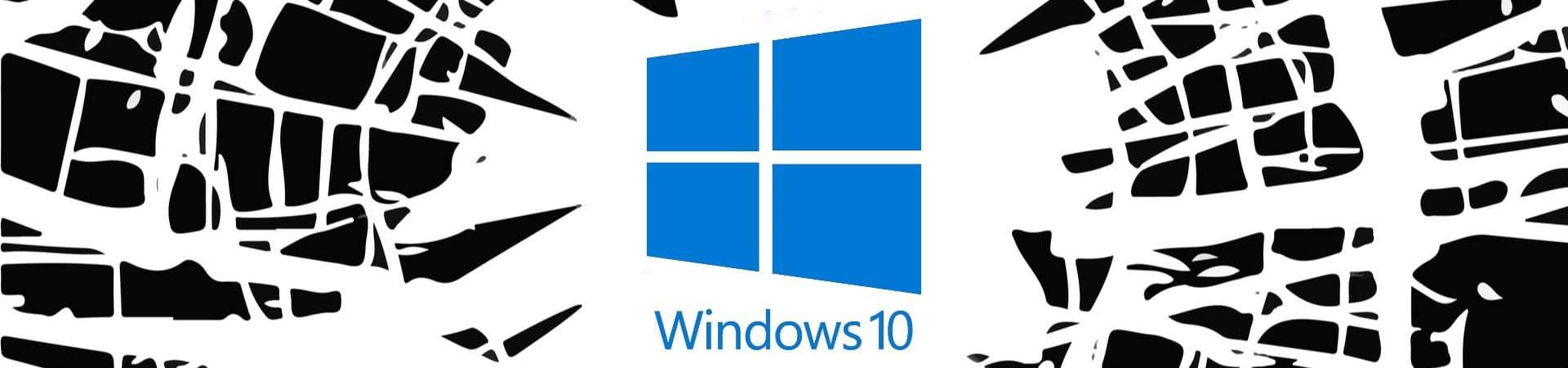 Imagem mostra um vidro estilhaçado com a logomarca do Windows 10 ao centro