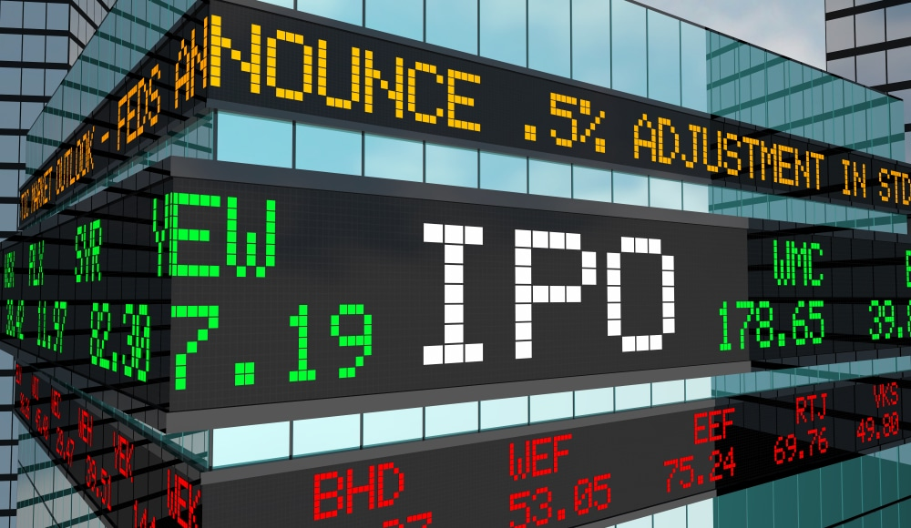 Illustration shows stock exchange sign with the initials IPO