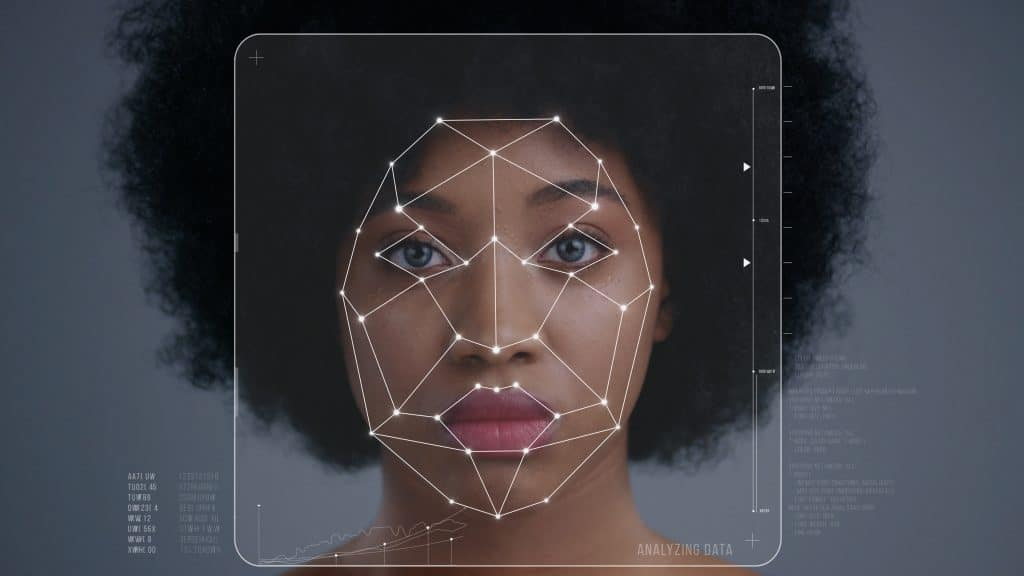 Black woman undergoing facial recognition