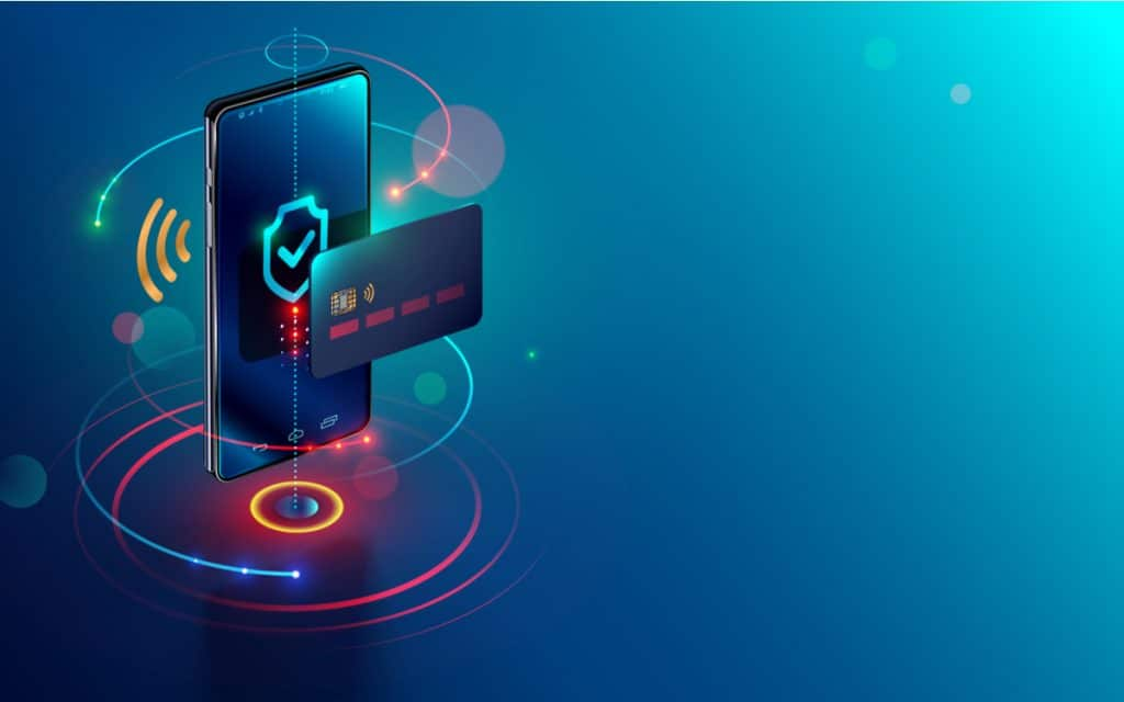 Ilustração de um celular com uma imagem de um escudo de proteção na tela, à frente aparece um cartão de crédito e o conjunto demonstra um banco digital