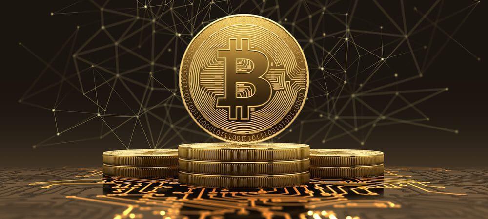 Imagem mostra uma moeda virtual, com o símbolo da bitcoin