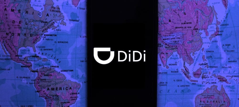 Smartphone displays didi chuxing app logo, Didi Chuxing transport app on the screen, in the background you can see a world map