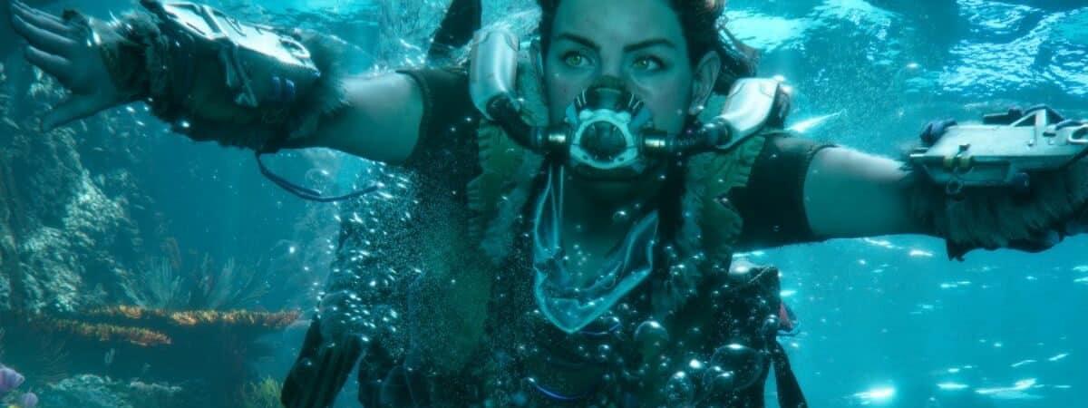 Aloy, protagonista do jogo, explora ambiente subaquático com respirador.