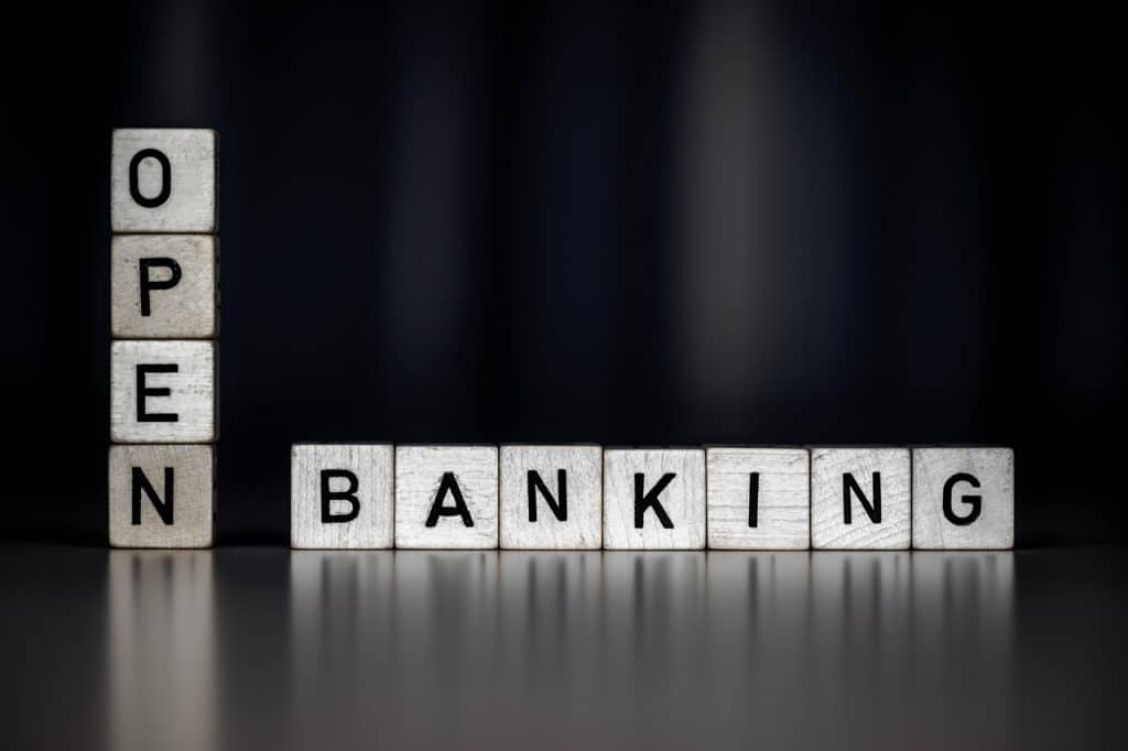 Black background image shows some stacked cubes, each with a letter, forming the word open banking