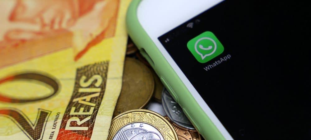 Logotipo de WhatsApp junto a billetes