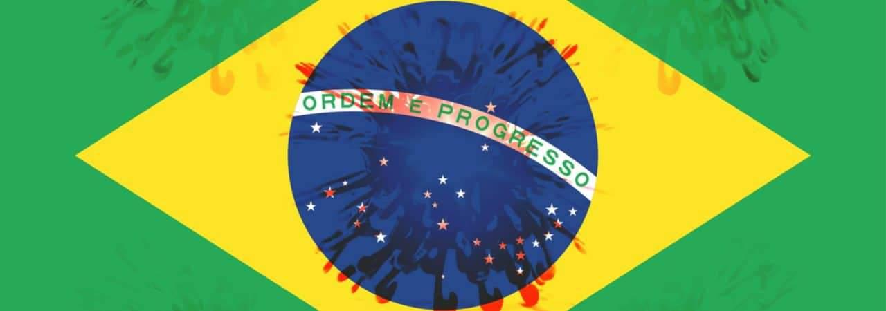 Imagem mostra a bandeira do Brasil com pequenos vírus a rodeando