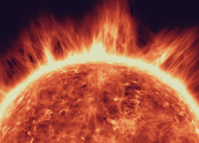 Imagem conceitual mostra uma explosão solar, com apenas o topo do sol visto na figura