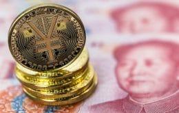 China avança com implementação do yuan digital, mas riscos ameaçam economia global
