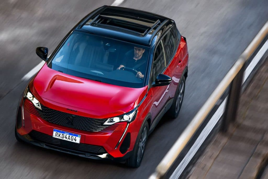 Red unit of the new Peugeot 3008, seen from above, on the road.
