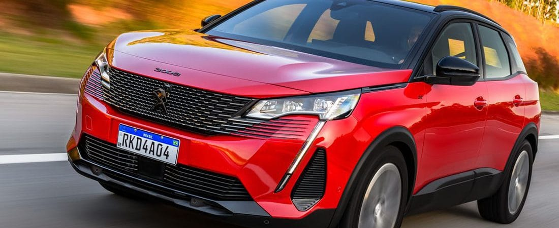 Red drive of the new Peugeot 3008 on the road.