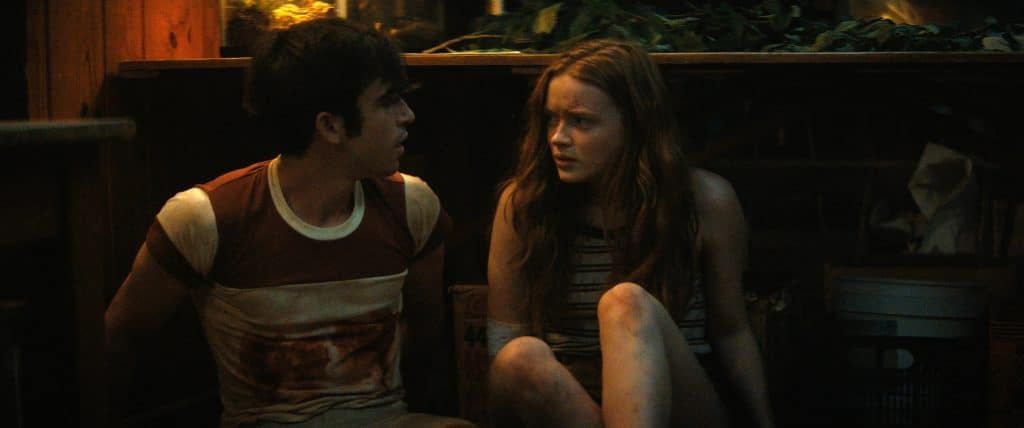 """Ted Sutherland and """"Nick"""" and Sadie Sink is """"Ziggy"""" in 'Fear Street: 1978 – Part 2'. Image: Netflix/Disclosure"""