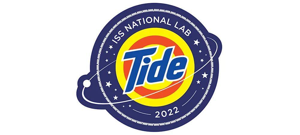 Logo do teste do sabão Tide no espaço