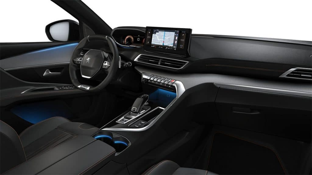 Image shows the vehicle's interior, highlighting the driver's seat, steering and gearshift.