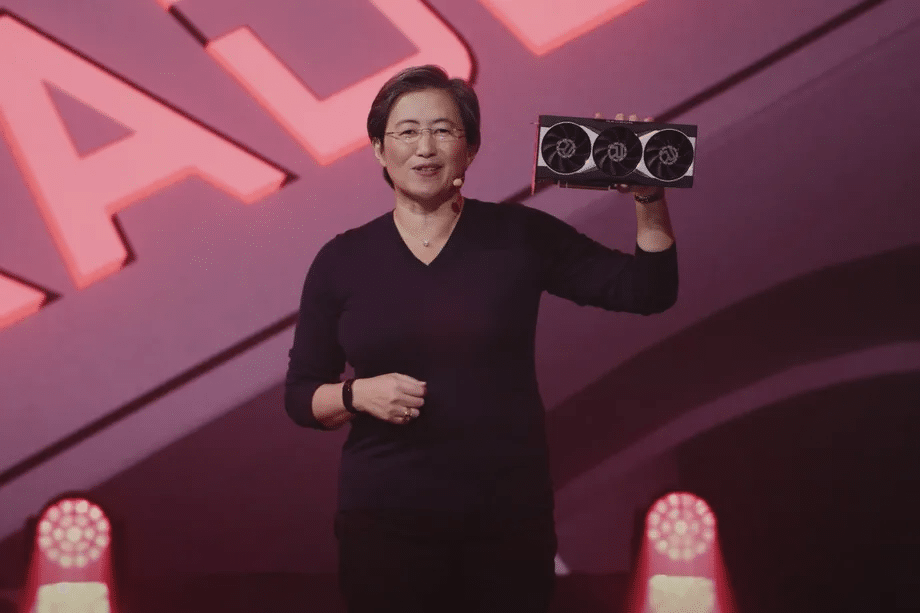 Image shows AMD CEO Lisa Su holding an RX 6000 graphics card during Computex 2020.
