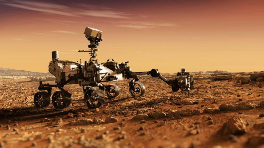Imagem mostra renderização 3D do rover Perseverance em Marte, transitando pelo solo do planeta vermelho