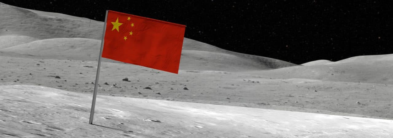 Image shows the flag of China positioned on the surface of the Moon