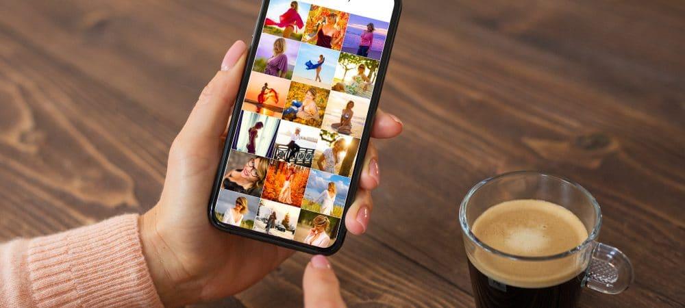 Celular aberto na galeria de fotos com uma xícara de café do lado