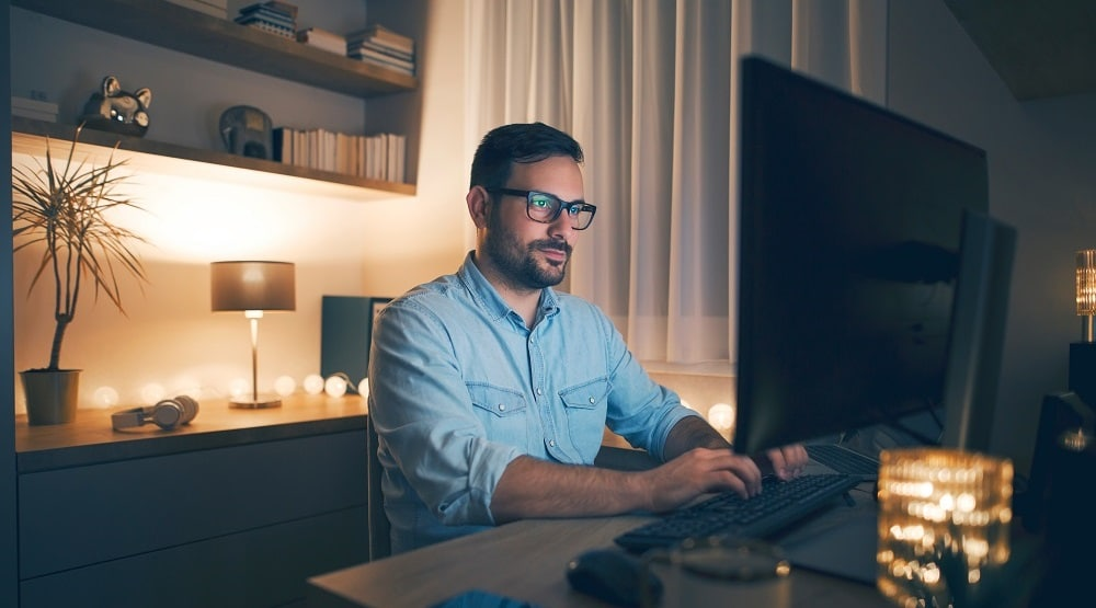 man working at home office