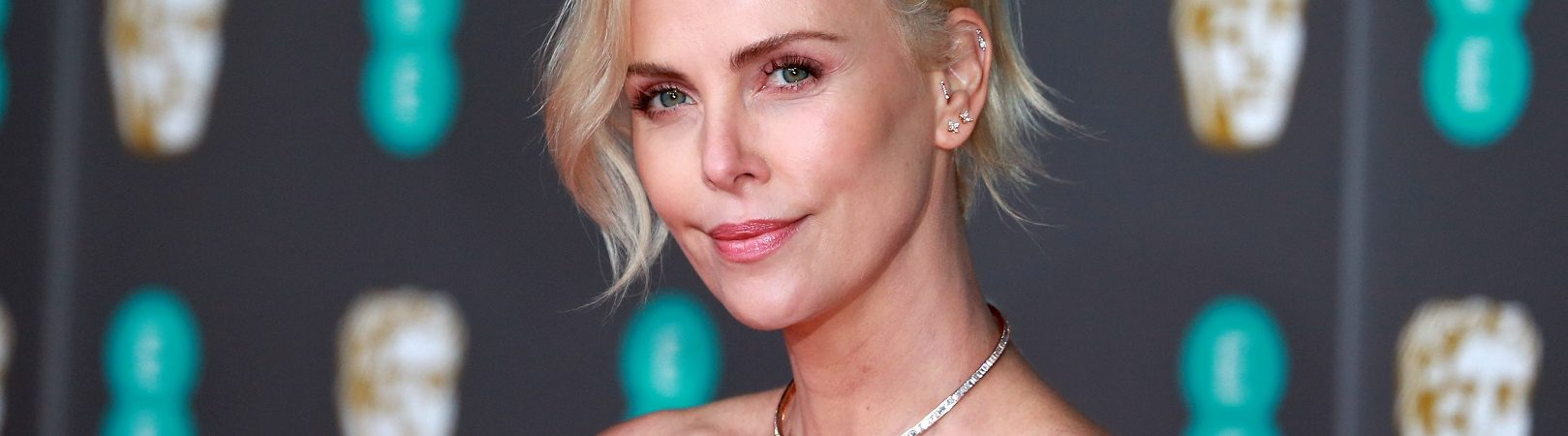 Charlize Theron attends the British Academy Film Awards at the Royal Albert Hall in London, UK. Image: Cubankite/Shuttestock