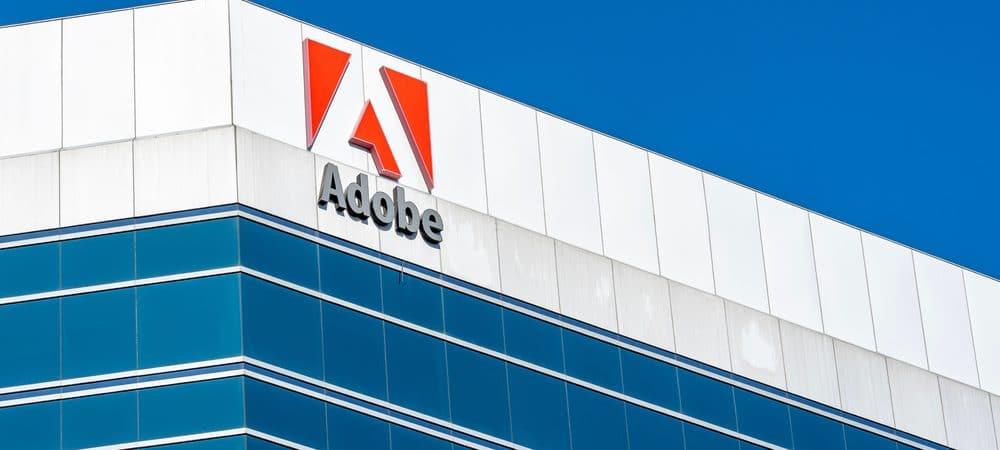 Imagem mostra o topo de um prédio comercial com o logotipo da Adobe na fachada