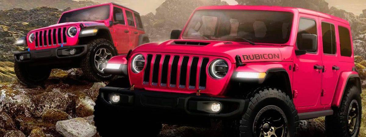 dois jeeps em meio a terreno rochoso