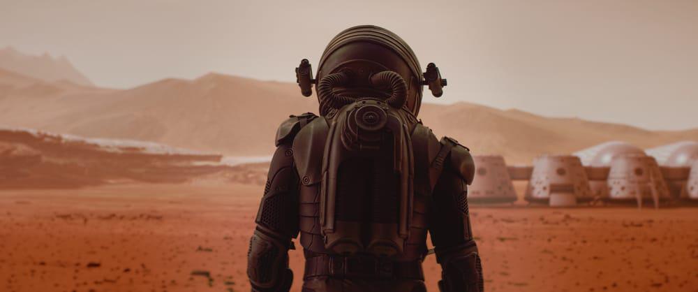 Imagem mostra astronautas caminhando por Marte, em uma imagem que simboliza a colonização do planeta vermelho