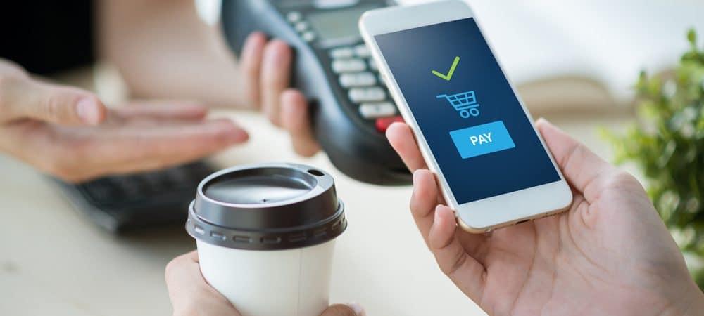 Imagem mostra conceito de compra usando o smartphone como plataforma de pagamento digital