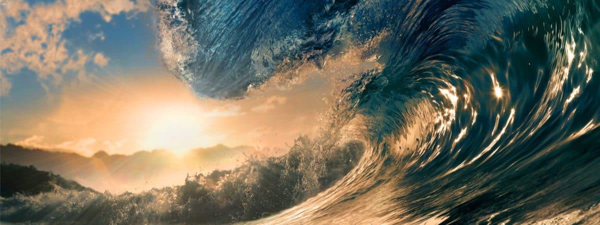 Gran ola reproducida en la ilustración con el sol de la tarde de fondo