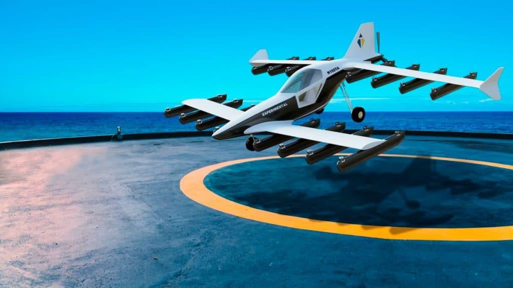 evtol de duas asas levantando voo em hangar no meio do mar
